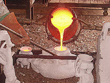 "Molten Bronze is Poured into the Front Shell of ""Sunnyside Up"" ~ Step Nine: The Molten Bronze ~ Persons Seven, Eight & Nine"