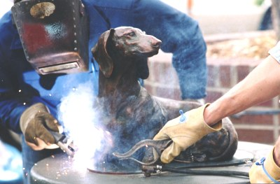 So Good To See You bronze Dachshund sculpture being welded