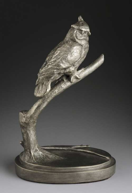 a bronze owl sculpture created by Joy Beckner